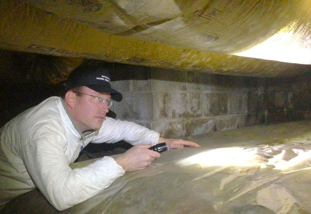 Cameron inspects a crawlspace
